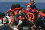 Syrian and Afghan refugees on raft reaching the Greek island of Lesbos, September 13, 2015. Reuters