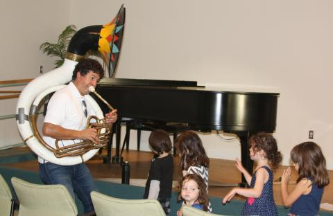 Ryan Zawel Leading Children with His Tuba
